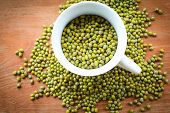 Mung Beans / Pile Of Mung Beans Seed In White Cup Top View poster