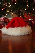 Santa Hat. Santa Claus Hat under a Christmas Tree. Santa was here. poster