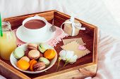 Breakfast In Bed With Empty Blank Card For Text. Cup Of Coffee, Juice, Macaroons, Rose Flower And Gi poster