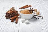 Brown Cinnamon Granulated And Cane Cubes Sugar With Different Spices For Confection poster