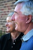 picture of senior-citizen  - Happy Senior Couple smiling outside in front of their house - JPG