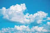 White Fluffy Cloud On Blue Sky. Cloudscape Photo Background. Optimistic Skyscape With Fluffy Cloud.  poster