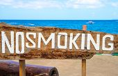No Smoking Sign On Driftwood By Sea. Prohibition Of Smoke On Tropical Beach. Clean Seaside Environme poster