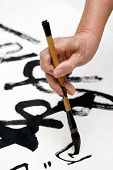 picture of chinese calligraphy  - A old man writing Chinese calligraphy in holidays - JPG