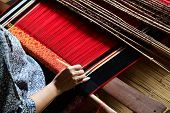 foto of loom  - classic asian loom at work - JPG