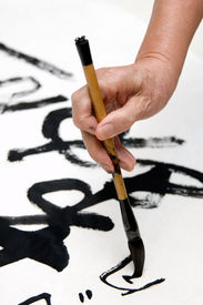 image of chinese calligraphy  - A old man writing Chinese calligraphy in holidays - JPG