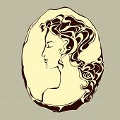 stock photo of cameos  - antique cameo with a female portrait with magnificent hair - JPG