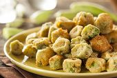 picture of okras  - Organic Homemade Fried Green Okra against a Background - JPG