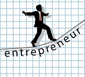 picture of start over  - Entrepreneur business man walks on financial tightrope to make start up success - JPG