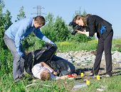 image of morbid  - Two criminalists working on a crime scene - JPG