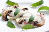 stock photo of brie cheese  - cheese brie baked with mushrooms - JPG