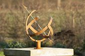 stock photo of sundial  - Iron sundial in the garden ancient clock - JPG