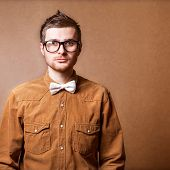 image of shoot out  - Hipster style guy in glasses studio shooting - JPG