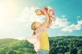 stock photo of mother baby nature  - happy family - JPG