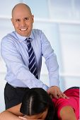 picture of chiropractor  - Male chiropractor working at his office with a patient - JPG