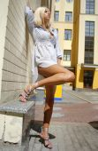 pic of streetwalkers  - blonde beautiful woman stands near wall of building - JPG