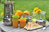 image of crockery  - ingredients and crockery for breakfast in the garden - JPG