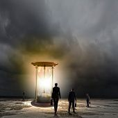 picture of hourglass figure  - Conceptual image of business people looking at sandglass - JPG