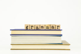 picture of dialect  - grammar word on wood stamps stack on books language and education concept - JPG