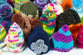 stock photo of knitted cap  - crowd of knitted bobble caps using for egg cozy and warm - JPG