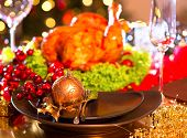 foto of turkey dinner  - Christmas table setting with turkey - JPG