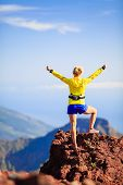 pic of mountain-climber  - Climbing hiking or trail cross country running woman and success in mountains - JPG