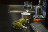 image of grenades  - Couple of hand grenades on a kitchen table indoor still life - JPG