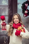 stock photo of guest-house  - Child girl welcome guests and holding presents - JPG