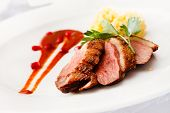 picture of duck breast  - roasted duck breast on Christmas table - JPG