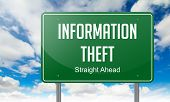picture of theft  - Highway Signpost with Information Theft Wording on Sky Background - JPG