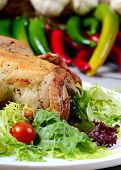 stock photo of turkey-hen  - The baked hen with salad close up - JPG