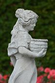 image of garden sculpture  - This is the beautiful rose garden with a sensual woman sculpture which belongs to the castle of Arcen - JPG