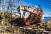 pic of wrecking  - The front end of an old passanger ship now wrecked and pulled on shore - JPG