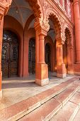 stock photo of synagogue  - arch enter to old red synagogue with wooden doors - JPG