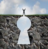 stock photo of keyhole  - Businessman standing on keyhole mountain cliff as a person with arms up in victory on top of a rock mountain shaped as a key hole business and finance symbol for financial and life success - JPG