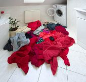 stock photo of dirty-laundry  - pile of dirty clothes ready for the wash in home bathroom - JPG