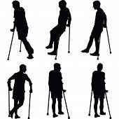 pic of crutch  - Man walk on crutches with broken leg - JPG