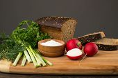 stock photo of radish  - Black bread radishes parsley onion and dill - JPG