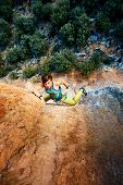 picture of climbing wall  - female rock climber climbs on a rocky wall - JPG