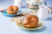 pic of custard  - Choux pastry eclair ring with custard cream served for tea selective focus - JPG
