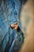 foto of climbing wall  - rock climber climbs on a rocky wall - JPG