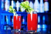 foto of bloody  - Two Bloody Mary cocktails shot on a bar counter in a night club - JPG