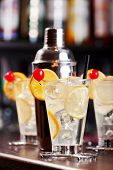 picture of collins  - Tom Collins cocktails shot on a bar counter in a night club - JPG