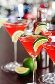 foto of cosmopolitan  - Four Cosmopolitan cocktails shot on a bar counter in a night club - JPG