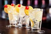 pic of collins  - Four Tom Collins cocktails shot on a bar counter - JPG