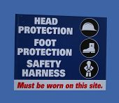 stock photo of hard_hat  - construction site safety with symbols of hard hats and harnesses - JPG