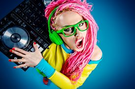 foto of dreadlock  - Expressive modern DJ girl wearing bright clothes - JPG