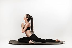 picture of yoga  - Young fit woman at yoga class - JPG