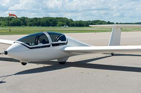 stock photo of glider  - glider or sailplane on runway at municipal airport in faribault minnesota - JPG