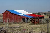 stock photo of texas flag  - Our Texas lonestar barn that serves as a rain shelter for the horses - JPG